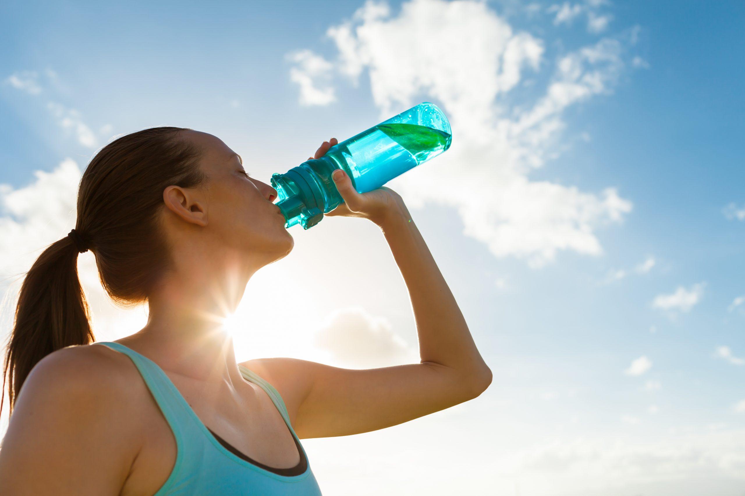 Woman drinking bottle of water.